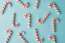 Creative Minimal Christmas Art. Pattern Made With Christmas Candies On Bright Blue Background. Flat Lay. Copy Space. Minimal Composition.