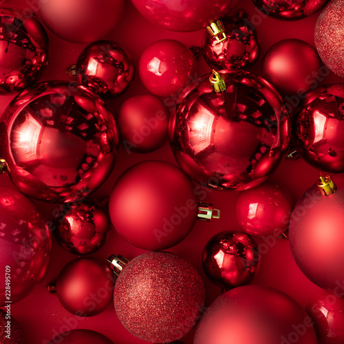 red christmas baubles decoration on red background new year party background minimal style