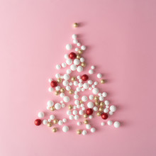 Christmas Tree Made Of Gold, Red And White Glitter Ball Decoration On Pink. New Year Greeting Card Party Minimal Style. Flat Lay. Holiday Concept.