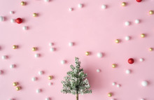 Christmas Tree With Red, Gold And White Glitter Decoration Balls. New Year Party Greeting Card Pink Background With Copy Space. Minimal Style. Flat Lay Composition.