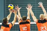 Triple block in men volleyball