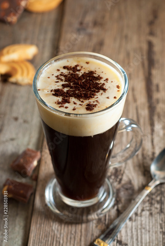 Foto op Canvas Chocolade Espresso coffee. Espresso drink with cream, topped with whipped cream. Rustic wooden background.