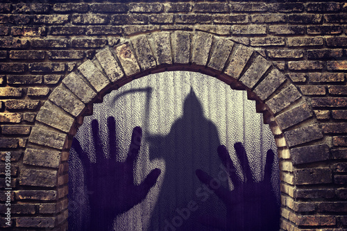 Photo  Silhouette of a hand the expression to be imprisoned ghost shadow standing in tu