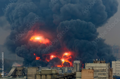 Powerful explosion with bright flashes and black smoke in the city Canvas