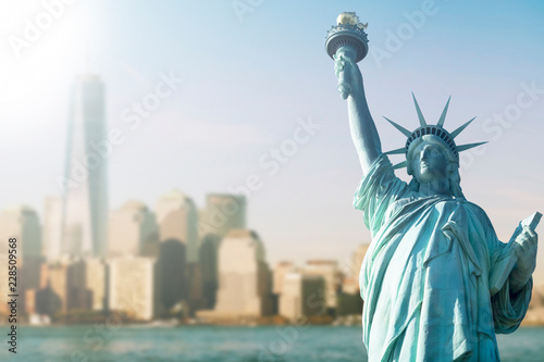 Photo  STATUE OF LIBERTY WITH BLUR BACKGROUND OF ONE WORLD TRADE CENTER AND SKYSCRAPERS