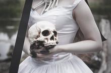 Human Skull In Creepy Bride Hands. Halloween Concept