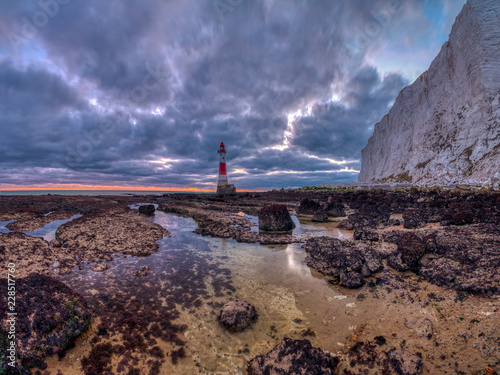 Fotografie, Obraz  Beachy Head Lighthouse at sunset into the blue hour - stitched panorama processe