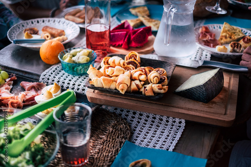 Wallpaper Mural Real scene of a wooden table at home or bar  restaurant full of food and drinks to enjoy the night together with friends celebrating