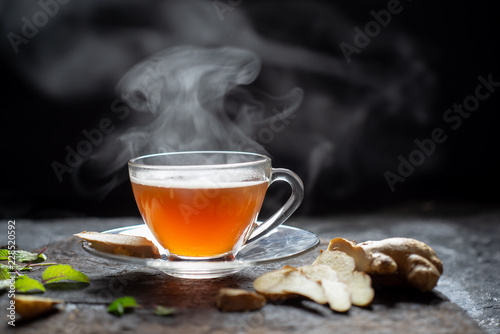 Recess Fitting Tea Hot Ginger tea in a glass on wood background.Hot drink . Copy space.