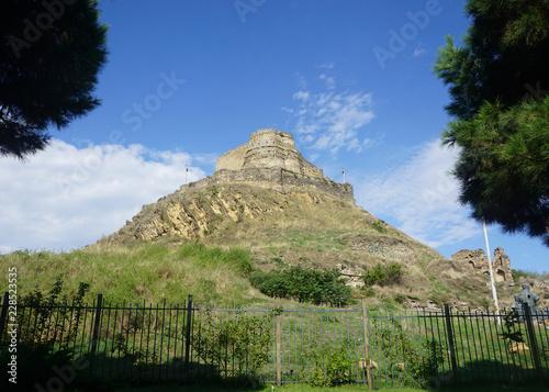 Foto  Gori Fortress Fence and Castle Common View