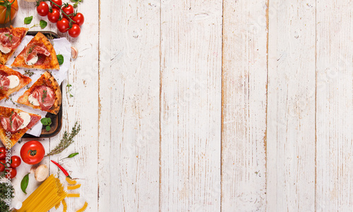 Italian food ingredients on old wooden background