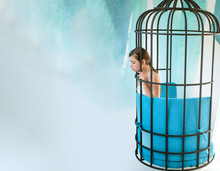 Imagintion And Inspiration. Modern Furniture Design And Home Comfort. Prisoner Woman In Cage. Fashion Slave In Captivity Of Beauty. Freedom Of Girl In Cage Chair. Woman In Cage, Copy Space