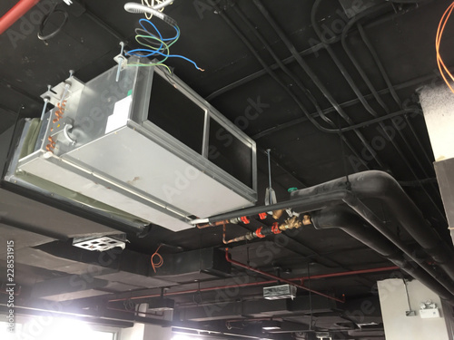 Photo Installation of Air handing unit or Fan coil unit in loft office