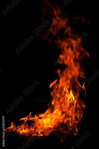 Obraz red and orange burning fire flames on black background. - fototapety do salonu
