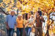 canvas print picture - Multl generation family in autumn park having fun