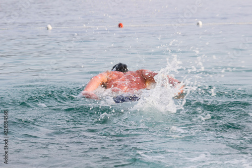 Swimmer dives into the depths of the sea. Background #228554568