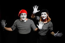 Two Mimes Touching Invisible W...