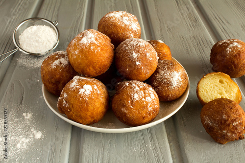 Homemade cottage cheese donuts on the grey  wooden background Fototapeta
