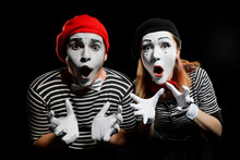 Amazed Mimes On Black Background