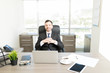 Confident Entrepreneur Smiling At Desk In Office