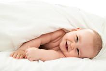Happy Cute Baby Lying On White...