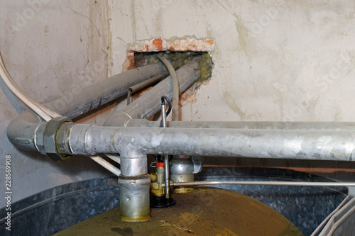 Heating oil tank pipes  Overfilling has covered container