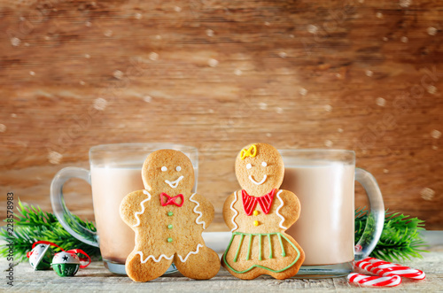 Gingerbread cookies with cocoa on a dark wood background for Christmas