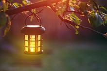Burning Lantern Hanging From A...