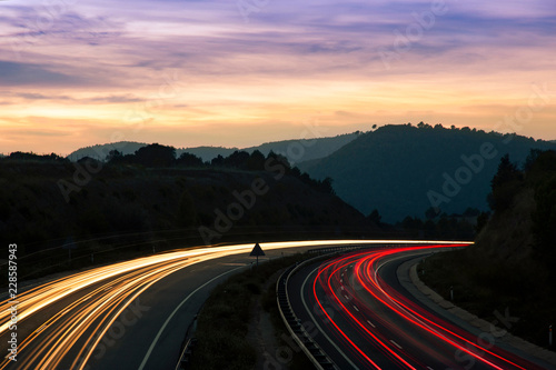 Poster Autoroute nuit Highway Traffic Light Trails and Landscape With Mountains