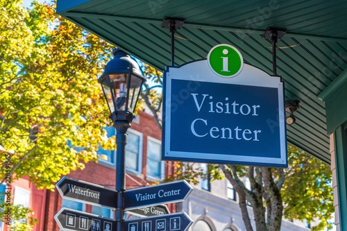 Photo Visitor Center Sign by Lamp Post