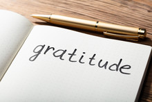 Gratitude Word With Pen On Not...