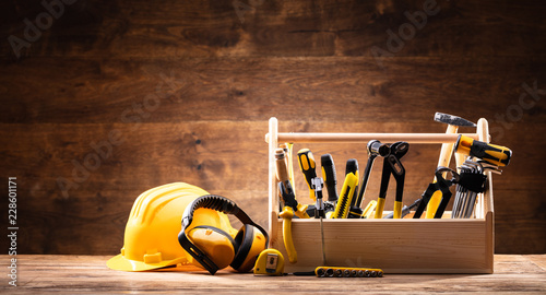 Fotografia  Safety Equipment Near Toolbox With Various Worktools