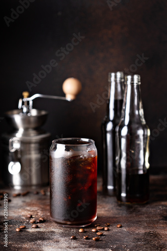 Foto Cold brew iced coffee in glass bottles