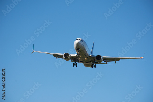 Photo  737 MAX 8 - Commercial Jet on Final Approach to an Airport - Vacation and Holiday Travel by Air