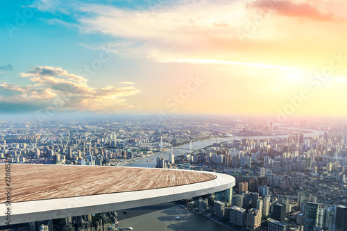 Canvastavla Panoramic Shanghai skyline and buildings with empty wooden square floor platform