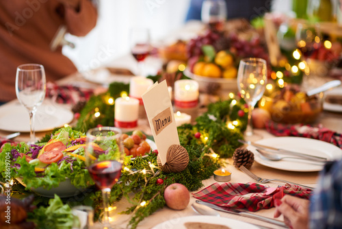 Menu for dinner on decorated Christmas table
