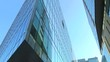 Moving among modern office building. Glass and reflections. Steadicam shot