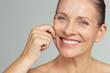 Leinwandbild Motiv Beauty mature woman pulling perfect skin