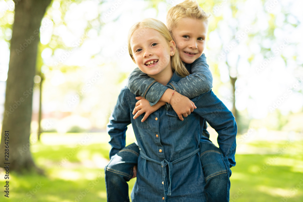 Fototapety, obrazy: A Picture of brother and sister having fun in the park