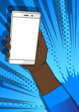 Afro American Hand Holding White Cellphone With White Screen. Cartoon Pop Art Retro Vector Illustration Drawing In Comic Book Style.