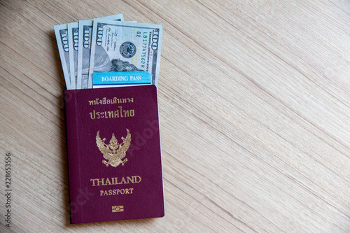Thai passport, dollars banknote, airline ticket  time to