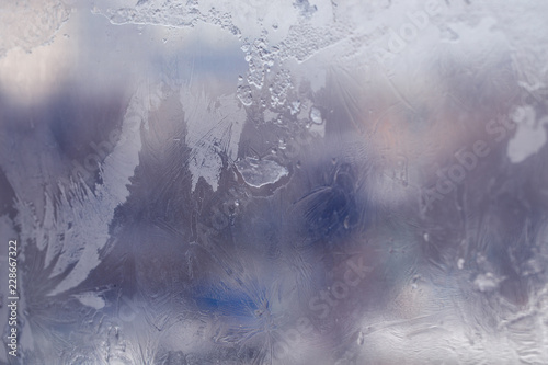 Fototapety, obrazy: Winter ice pattern on the frozen window. Texture, background for inserting text. New Year theme. Winter. Cold.