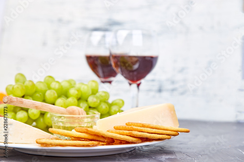 Foto op Canvas Buffet, Bar Cheese plate variety, and wine in glasses
