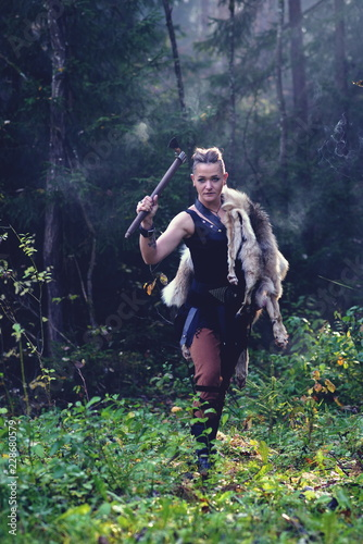 Fotografie, Obraz  Viking woman with axe in a traditional warrior clothes