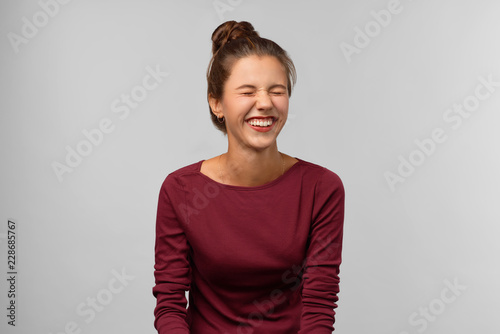 Fotografie, Obraz  A happy pleased woman feels well isolated on background