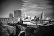 A beautiful black and white cityscape of modern Raleigh North Carolina with a train on a curving railroad. Copy space.