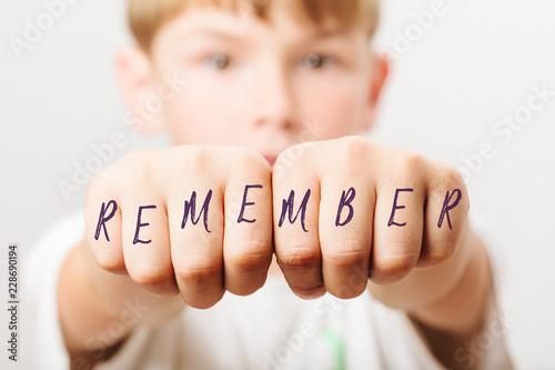 Obraz Remember word on fists of school boy - fototapety do salonu