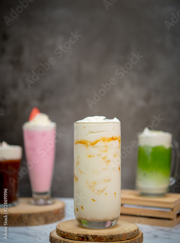 milk with caramels in glass