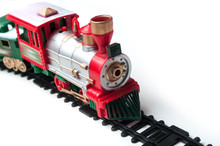 Closeup Of Miniature Plastic Train On White Background