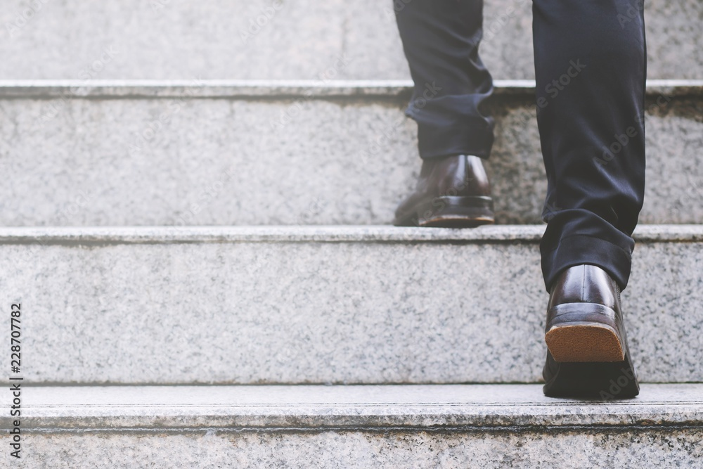 Fototapety, obrazy: Close up legs shoes of young business man One person walking stepping going up the stairs in modern city, go up, success, grow up. with filter Tones retro vintage warm effect. stairway